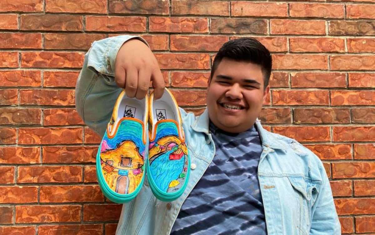 Roger Zamarripa Jr. poses with the Vans he designed as part of the shoe brand's competition for high school students.